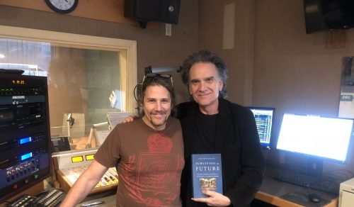 Peter Buffett and Jimmy Buff pose with David Fleming's Surviving the Future